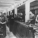 Prisoners working on a rifle production line in the SS-owned munitions factory at Dachau